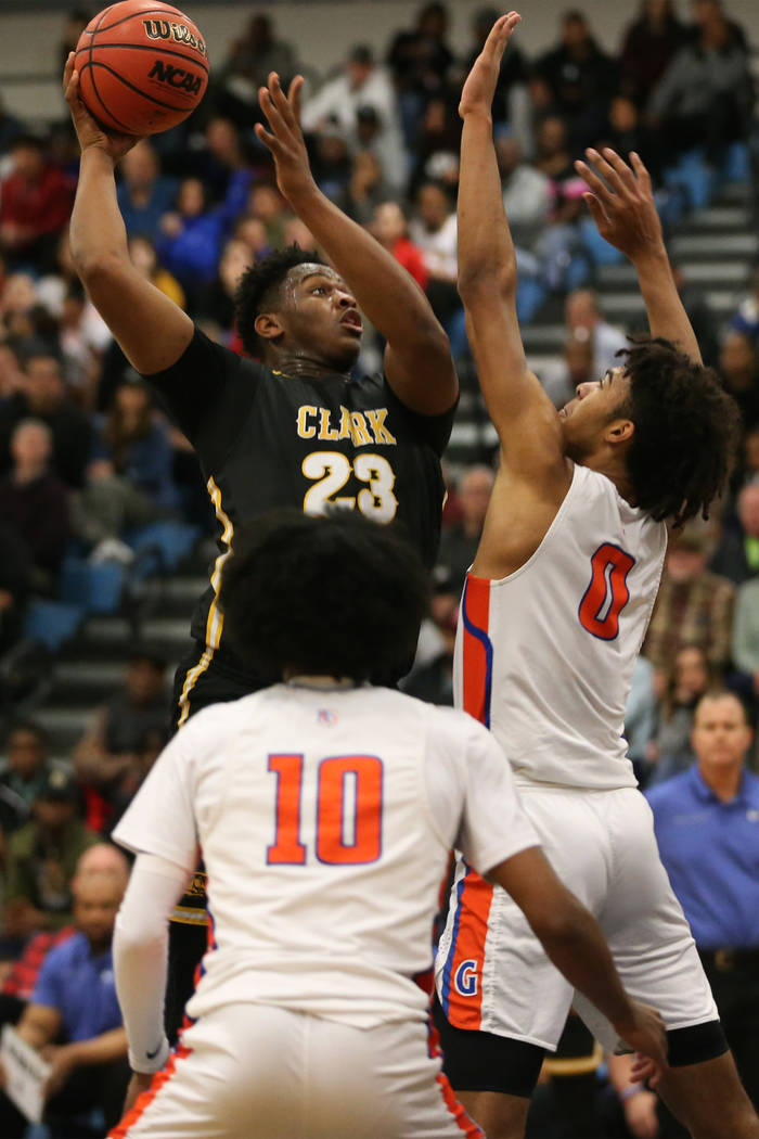 Clark's Antwon Jackson (23) goes up for a shot against Bishop Gorman's Isaiah Cottrell (0) in the Desert Region boys basketball championship game at Foothill High School in Henderson, Saturday, Fe ...