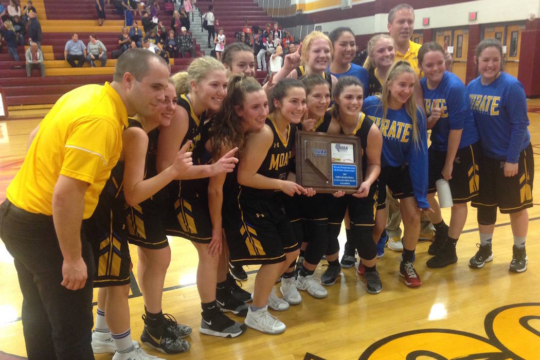 Moapa Valley poses with the Class 3A Southern Region championship trophy after beating Boulder City, 50-44 in the region final at Del Sol on Monday, Feb. 25, 2019. (Bartt Davis/Las Vegas Review-Jo ...