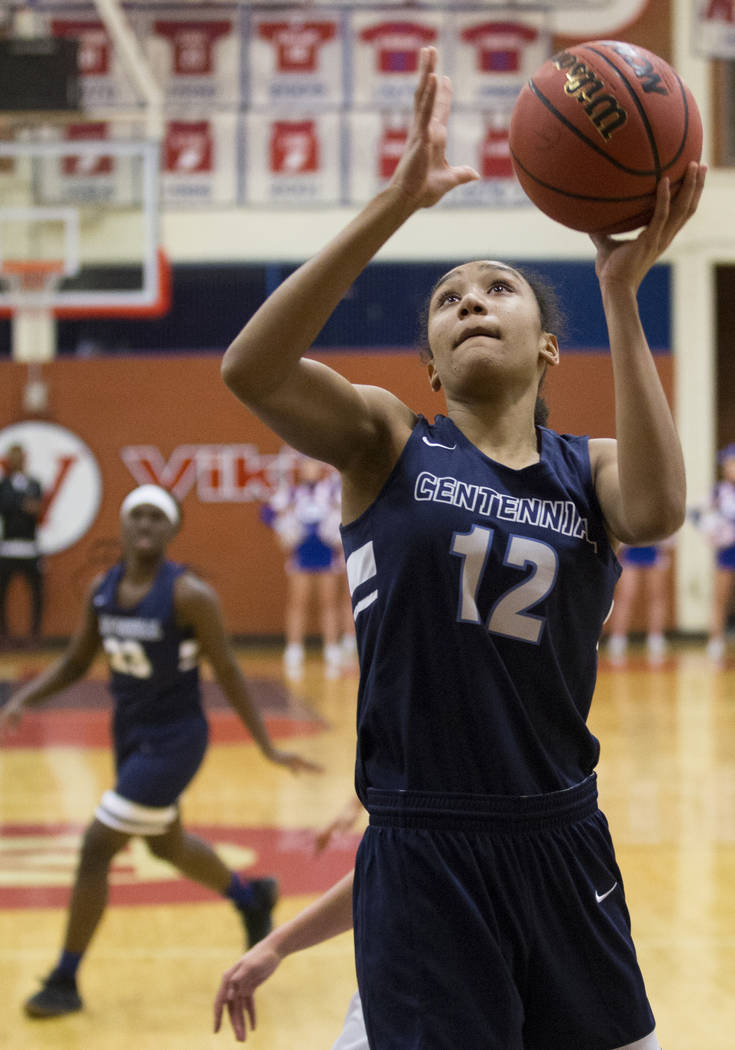 Centennial junior Aishah Brown (12) converts a fast-break layup in the fourth quarter during the Bulldogs game with Bishop Gorman during the Southern Nevada girls basketball championship game on M ...