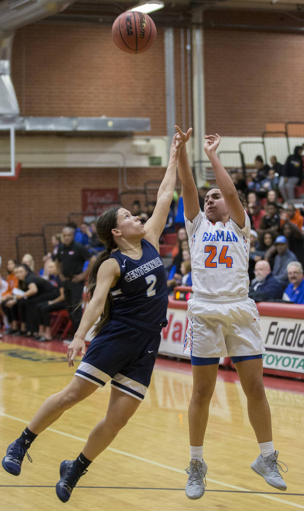 Bishop Gorman junior Bentleigh Hoskins (24) shoots a three point shot over Centennial senior Melanie Isbell (2) in the second quarter during the Southern Nevada girls basketball championship game ...