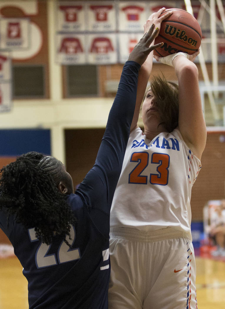 Bishop Gorman senior Tierney Holcombe (23) shoots over Centennial senior Eboni Walker (22) in the second quarter during the Southern Nevada girls basketball championship game on Monday, Feb. 25, 2 ...