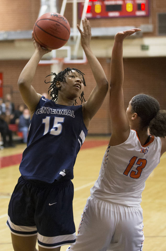 Centennial junior Daejah Phillips (15) shoots over Bishop Gorman senior Georgia Ohiaeri (13) in the third quarter during the Southern Nevada girls basketball championship game on Monday, Feb. 25, ...