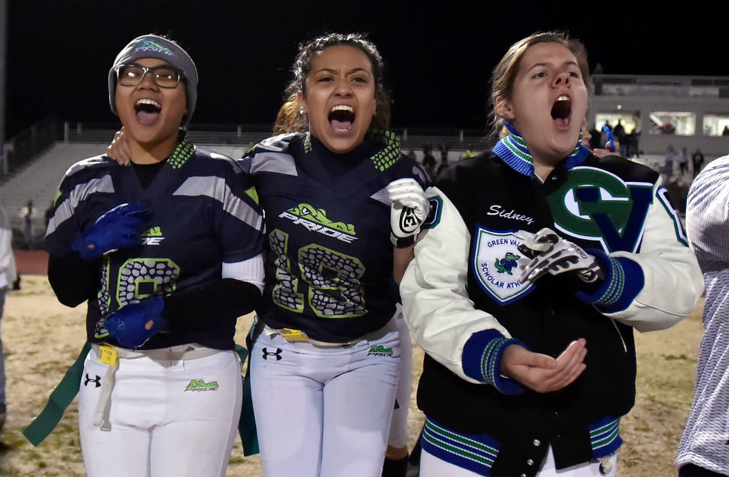 Green Valley's Anna Marie Arce, left, Justina Coronado and Sidney Rood cheer for their team during the final seconds of the Class 4A state flag football championship game against Bonanza at Cimarr ...