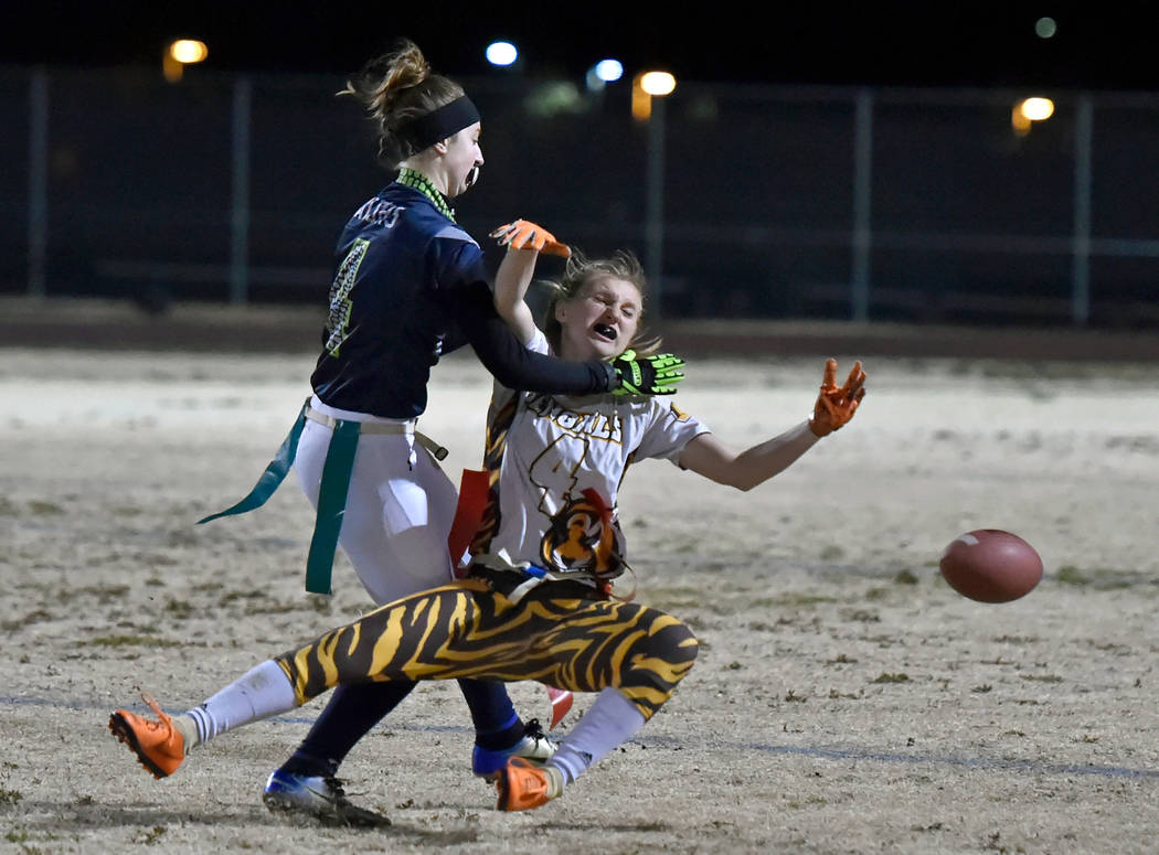 Green Valley's Hailee McKay, left, is called for pass interference against Bonanza's Shayne Dunn during Class 4A state flag football championship game at Cimarron High School Monday, Feb. 25, 2019 ...