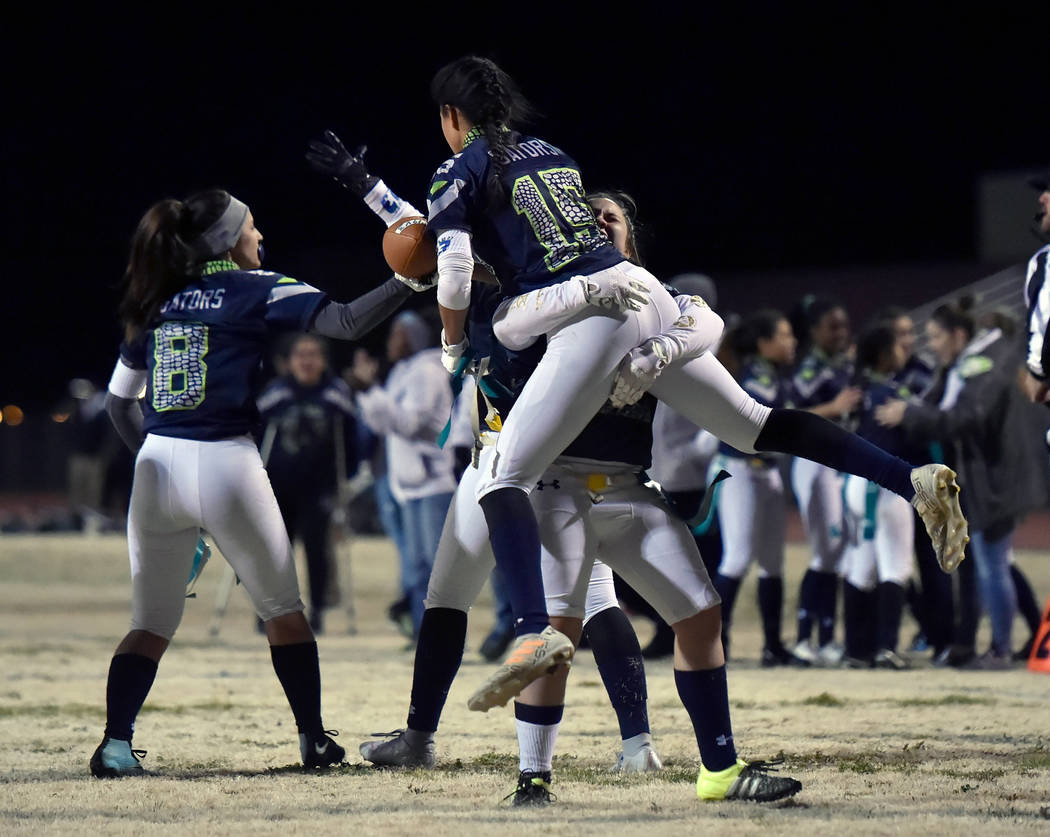 Green Valley's Jazlyn Camacho (15) is lifted into the air after completing the two-point conversion putting Green Valley ahead of Bonanza during Class 4A state flag football championship game at C ...