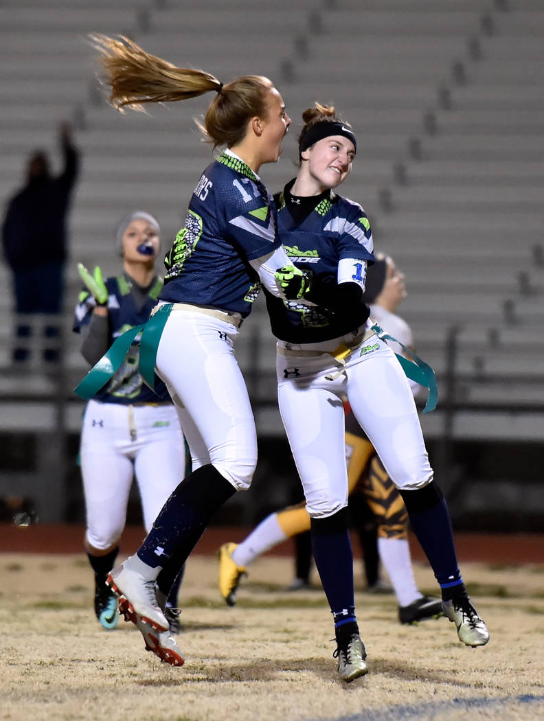 Green Valley's Nicolette De La Carrera (17) and Hailee McKay celebrate after the team scored a touchdown against Bonanza during Class 4A state flag football championship game at Cimarron High Scho ...