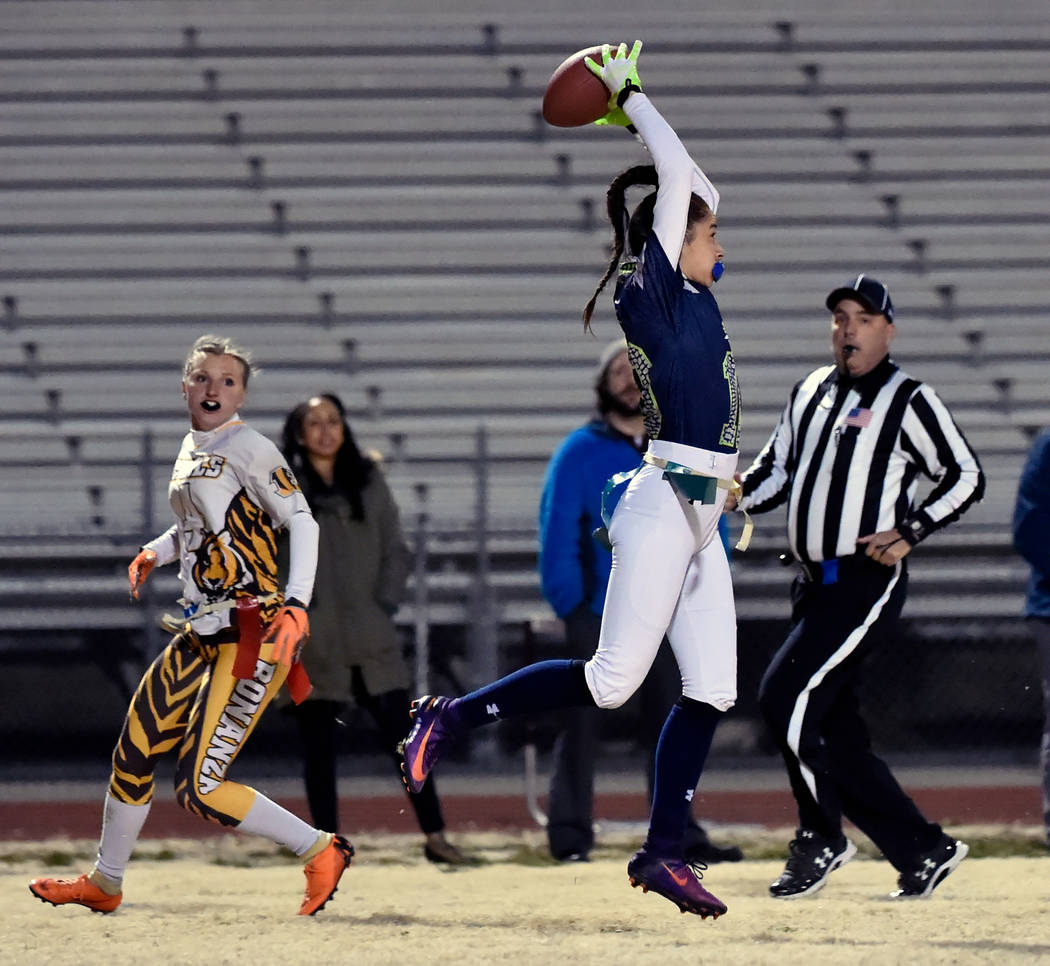 Green Valley's Rebecca Orozco (10) intercepts the all against Bonanza's Shayne Dunn (4) during Class 4A state flag football championship game at Cimarron High School Monday, Feb. 25, 2019, in Las ...