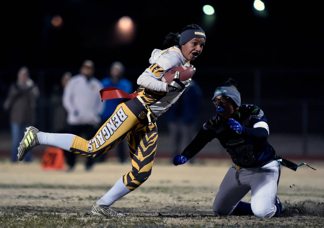 Bonanza's Ashley Vasquez (75) avoids a tackle from Green Valley's Anna Marie Arce during Class 4A state flag football championship game at Cimarron High School Monday, Feb. 25, 2019, in Las Vegas. ...