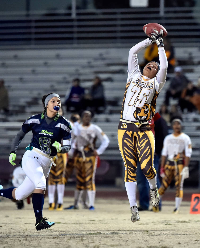 Bonanza's Ashley Vasquez (75) makes a catch against Green Valley's Anna Grave de Peralta (8) during Class 4A state flag football championship game at Cimarron High School Monday, Feb. 25, 2019, in ...