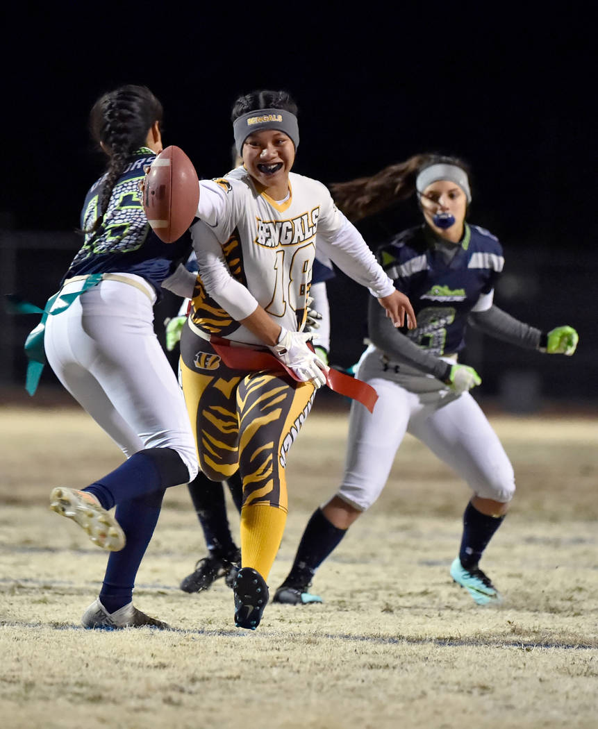 Bonanza's Cindylou Rasiang (18) carries the ball for a touchdown against Green Valley during Class 4A state flag football championship game at Cimarron High School Monday, Feb. 25, 2019, in Las Ve ...