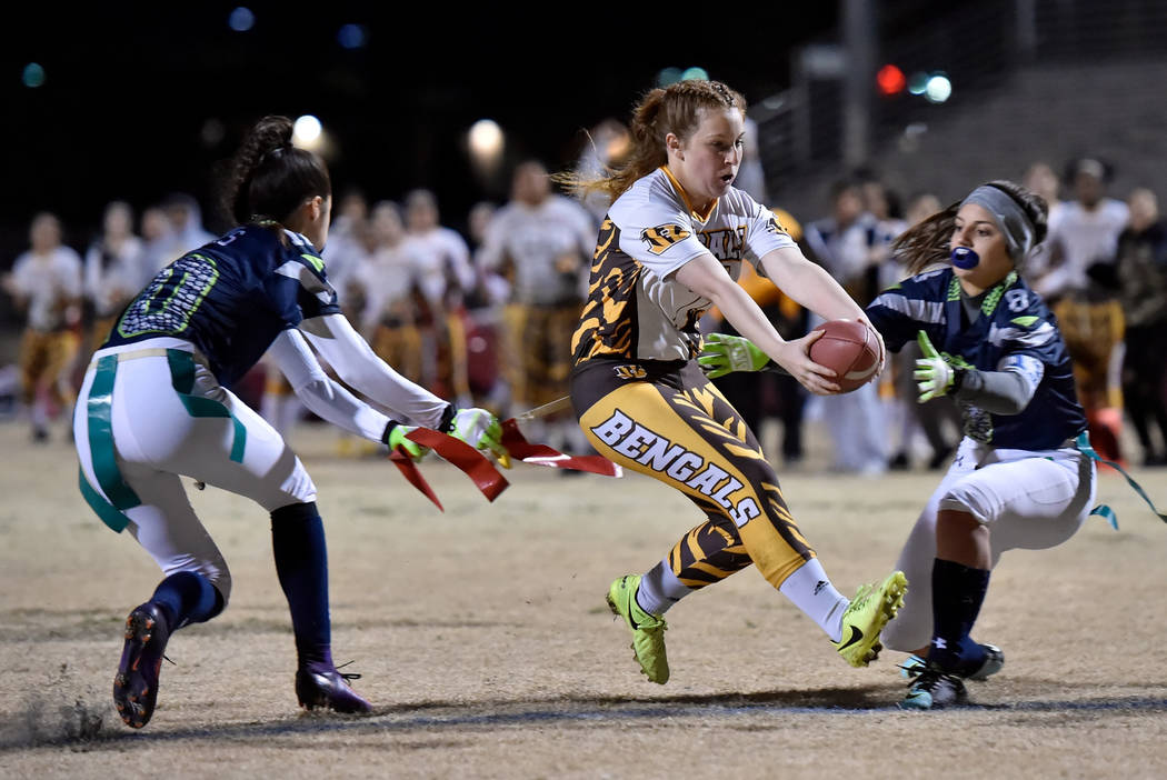 Bonanza's Charlene Beck (7) carries the ball for a touchdown against Green Valley during Class 4A state flag football championship game at Cimarron High School Monday, Feb. 25, 2019, in Las Vegas. ...
