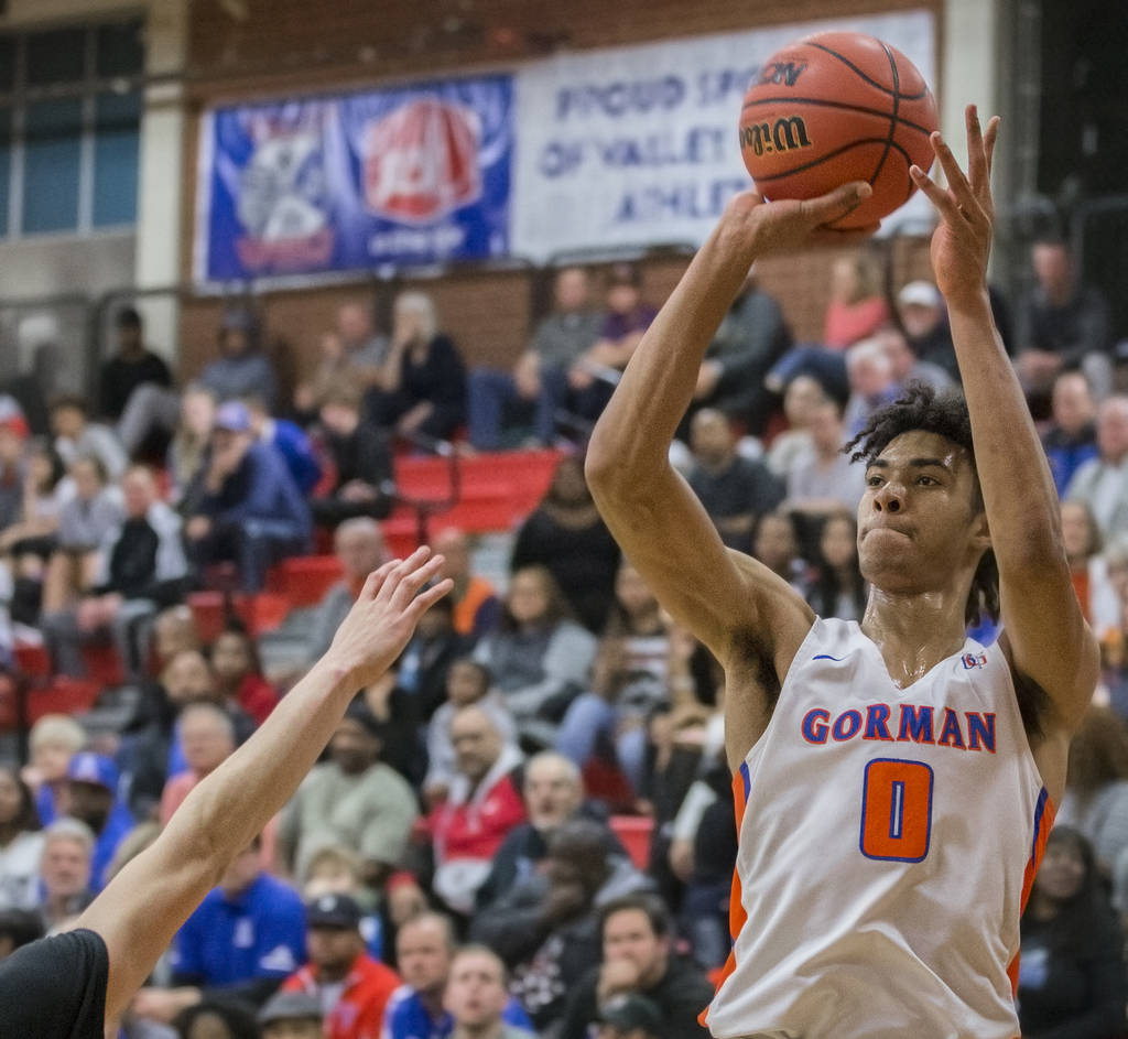 Bishop Gorman junior forward Isaiah Cottrell (0) shoots a corner three over a Desert Pines defender in the third quarter during the Southern Nevada boys basketball championship game on Monday, Feb ...