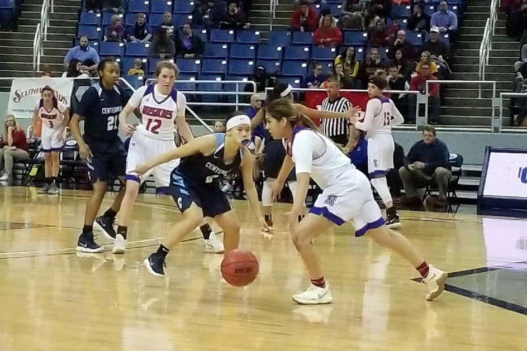 Melanie Isbell dribbles the ball against Reno on Thursday, Feb. 22, 2018 at Lawlor Events Center in Reno. Centennial beat Reno High 68-30 in the Class 4A state semifinals. (Damon Seiters/Las Vegas ...