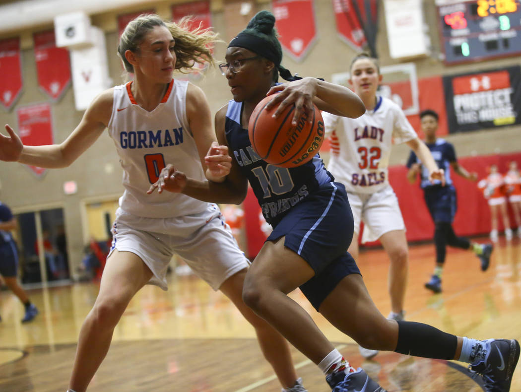 Canyon Springs' Sydnei Collier (10) drives the ball against Bishop Gorman's Izzy Westbrook (0) during the second half of a Class 4A state girls basketball quarterfinal game at Arbor View High Scho ...