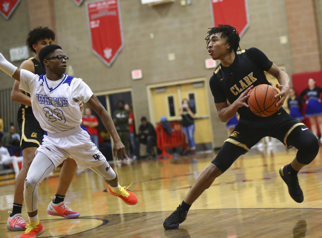 Clark's Frankie Collins (1) moves the ball around Desert Pines' LaRonte Dorsey (23) during the second half of a Class 4A state boys basketball quarterfinal game at Arbor View High School in Las V ...