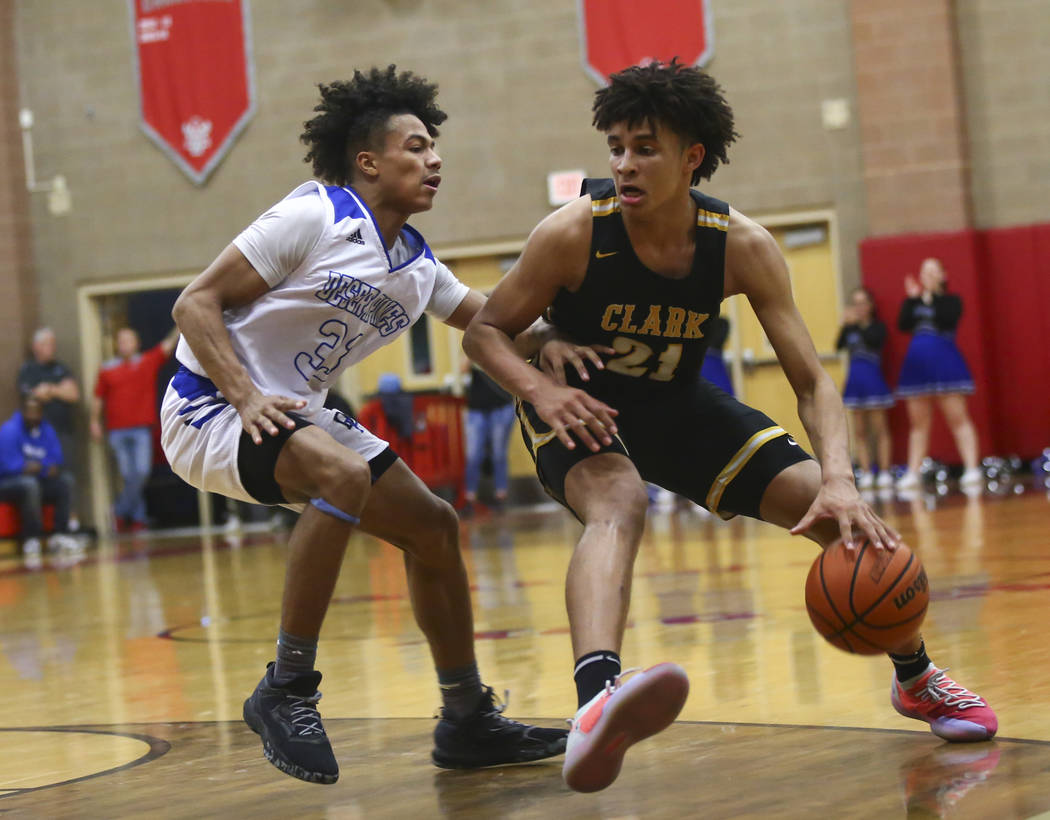 Clark's Jalen Hill (21) moves the ball around Desert Pines' Jamir Stephens (33) during the second half of a Class 4A state boys basketball quarterfinal game at Arbor View High School in Las Vegas ...
