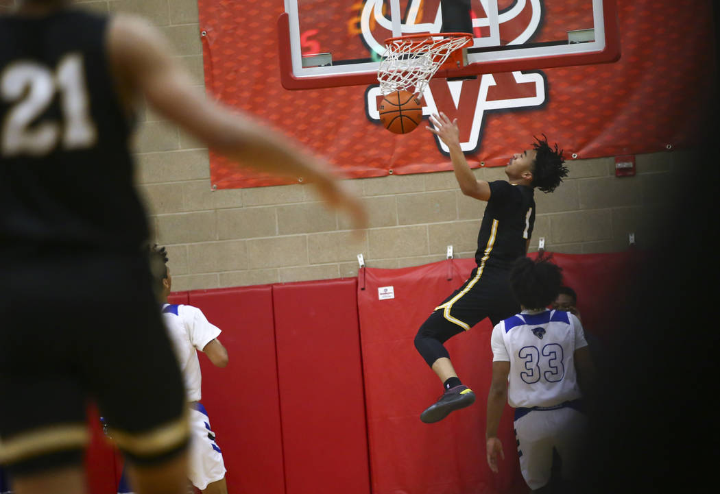 Clark's Frankie Collins (1) dunks against Desert Pines during the first half of a Class 4A state boys basketball quarterfinal game at Arbor View High School in Las Vegas on Wednesday, Feb. 27, 201 ...