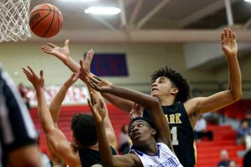 Clark's Jalen Hill, right, battles for a rebound against Desert Pines' Dayshawn Wiley (2) during the second half of a Class 4A state boys basketball quarterfinal game at Arbor View High School in ...