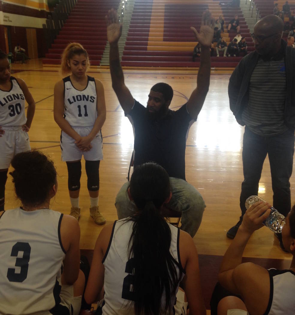 Calvary Chapel coach Shay Johnson talks to his team during the Lions' 40-33 win over Lincoln County in the Class 2A Southern Region championship game at Del Sol on Saturday, Feb. 23, 2019. Bartt D ...