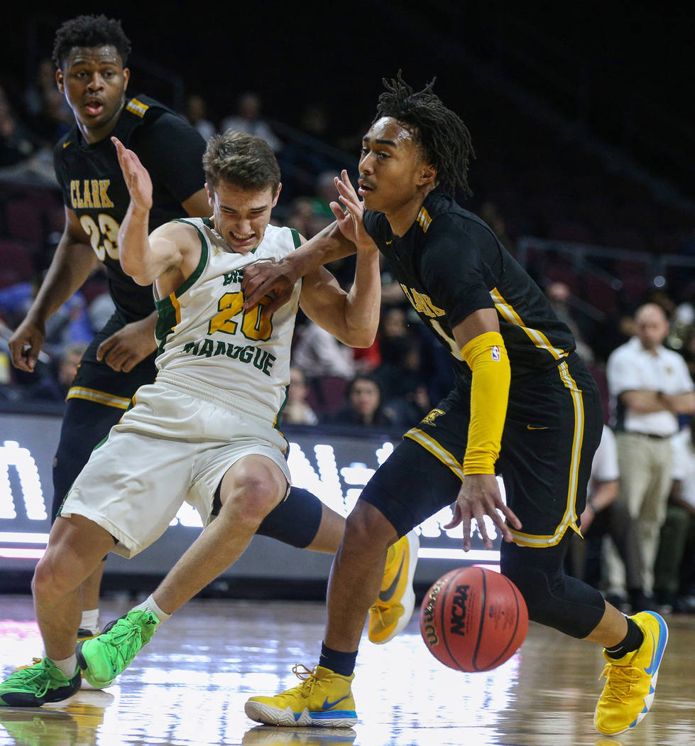 Clark's Frankie Collins (1) pushes back Bishop Manogue's Cort Ballinger (20) as Clark's Antwon Jackson (23) looks on during the first half of a Class 4A state boys basketball semifinal game at the ...