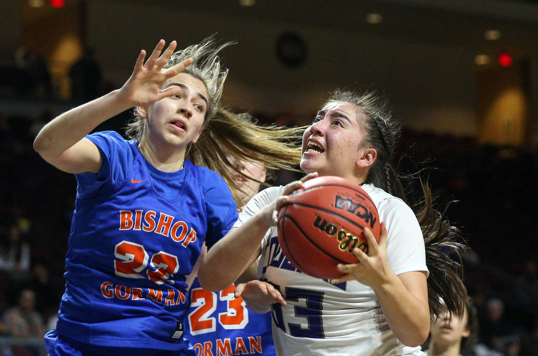 Spanish Springs' Mariah Barraza (33) drives to the net while being guarded by Bishop Gorman's Alexis Kruljac (22) during the second half of a Class 4A state girls basketball semifinal game at the ...