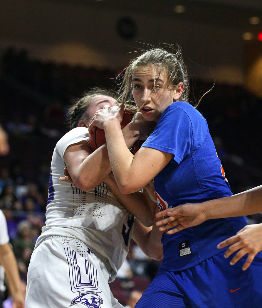Bishop Gorman's Alexis Kruljac (22) fights for the ball against Spanish Springs' Mariah Barraza (33) during the second half of a Class 4A state girls basketball semifinal game at the Orleans Arena ...