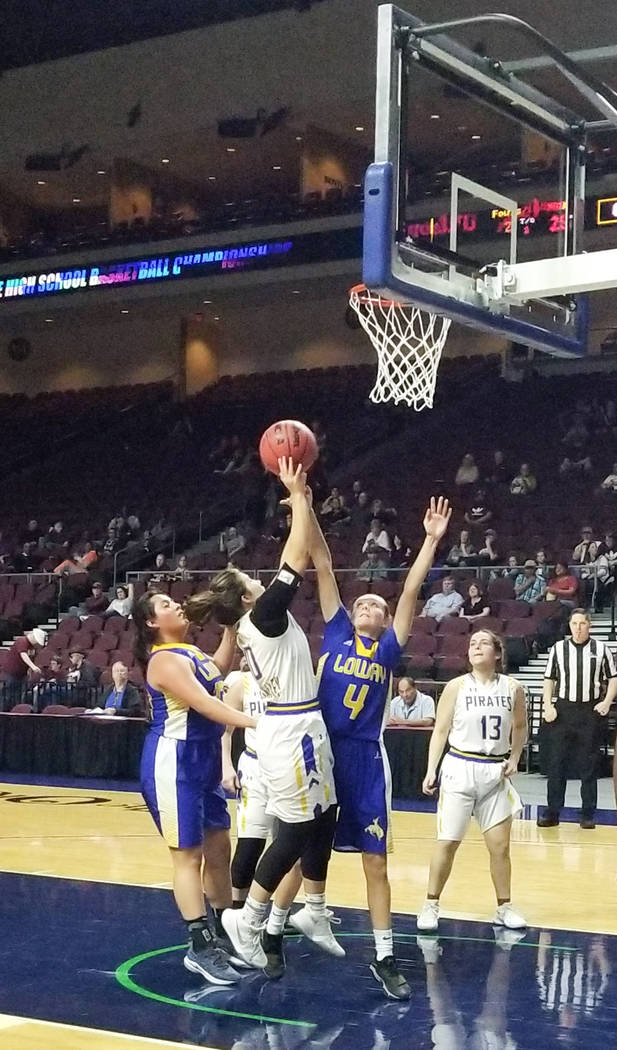 Moapa Valley's Peyton Schraft shoots over Lowry's Rebecca Kuskie in the Class 3A state semifinals at Orleans Arena on Friday, March 1, 2019. The Pirates won 43-38. (Damon Seiters/Las Vegas Review- ...
