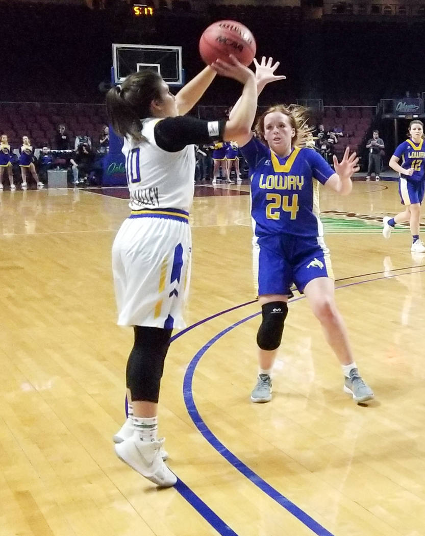 Moapa Valley's Peyton Schraft takes a jumper as Lowry's Sierra Maestrejuan defends in the Class 3A state semifinals at Orleans Arena on Friday, March 1, 2019. The Pirates won 43-38. (Damon Seiters ...
