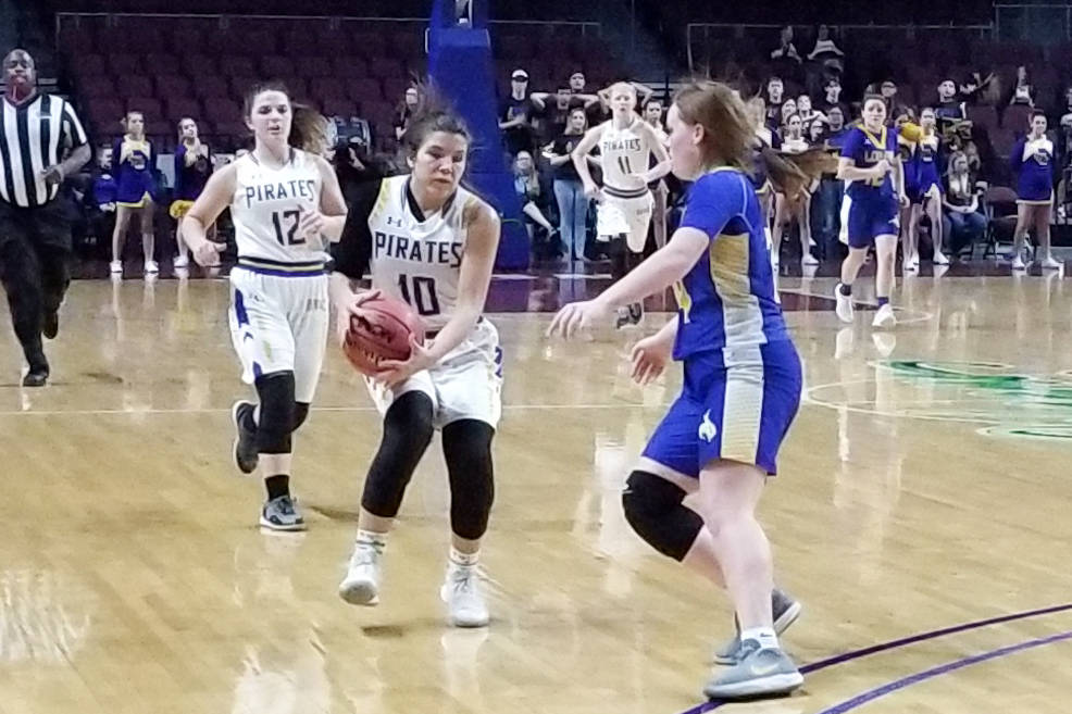 Moapa Valley's Peyton Schraft brings the ball down the floor against Lowry's Sierra Masestrejuan in the Class 3A state semifinals at Orleans Arena on Friday, March 1, 2019. The Pirates won 43-38. ...