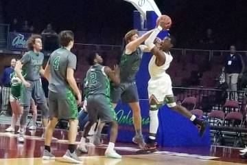 Mojave's Chris Jackson, right, looks to shoot over Churchill County's Thomas Steele in the Class 3A state semifinals at Orleans Arena on Friday, March 1, 2019. Churchill County won 60-59 in overti ...