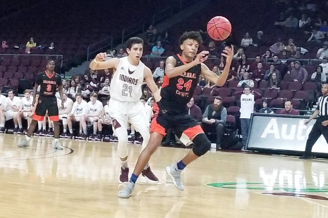 Chaparral's Sameal Anderson grabs a loose ball as Elko's Alex Klekas defends in the Class 3A state semifinals at Orleans Arena on Friday, March 1, 2019. Elko won 53-47. (Damon Seiters/Las Vegas Re ...