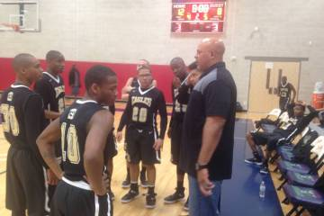 Spring Mountain coach Asad Ali talks to his team after the first quarter of the Golden Eagles' 42-37 win over Jackpot in a Class 1A state semifinal at SLAM Academy on Friday, March 1, 2019. Bartt ...