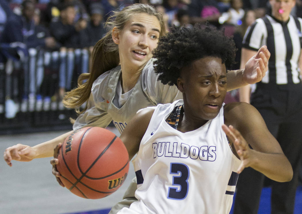 Centennial senior Quinece Hatcher (3) drives baseline past Bishop Gorman senior Lexi Kruljac (22) in the first quarter of the Class 4A girls state championship game on Friday, March 1, 2019, at Or ...
