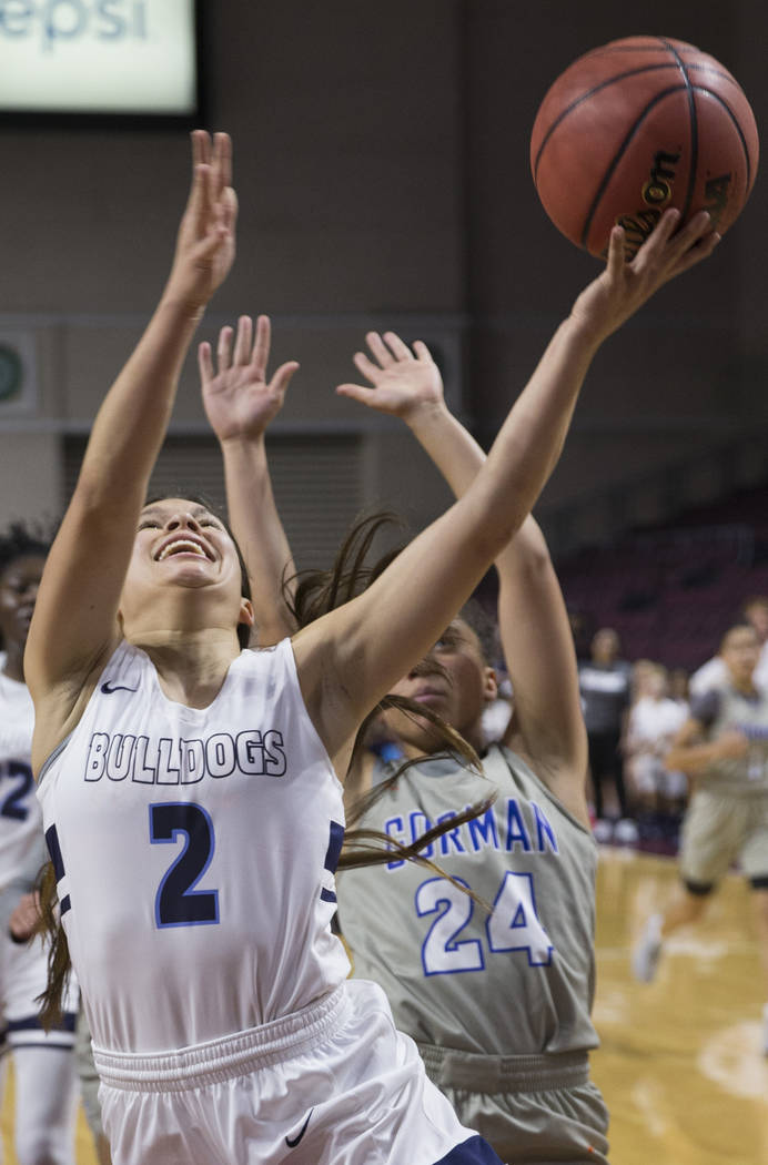 Centennial senior Melanie Isbell (2) drives past Bishop Gorman junior Bentleigh Hoskins (24) in the second quarter of the Class 4A girls state championship game on Friday, March 1, 2019, at Orlean ...