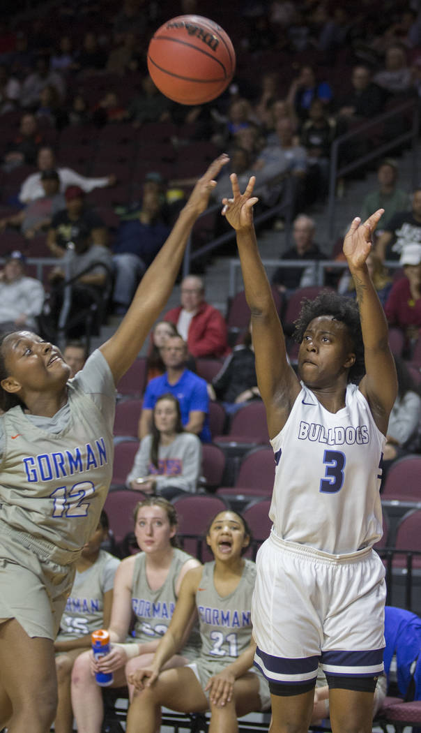 Centennial senior Quinece Hatcher (3) shoots a corner jump shot over Bishop Gorman senior Aaliyah Bey (12) in the second quarter of the Class 4A girls state championship game on Friday, March 1, 2 ...