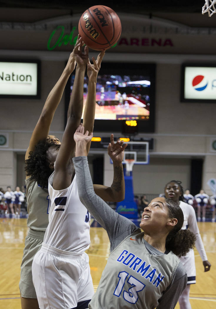 Bishop Gorman senior Georgia Ohiaeri (13) fights for a rebound with Centennial senior Quinece Hatcher (3) in the second quarter of the Class 4A girls state championship game on Friday, March 1, 20 ...