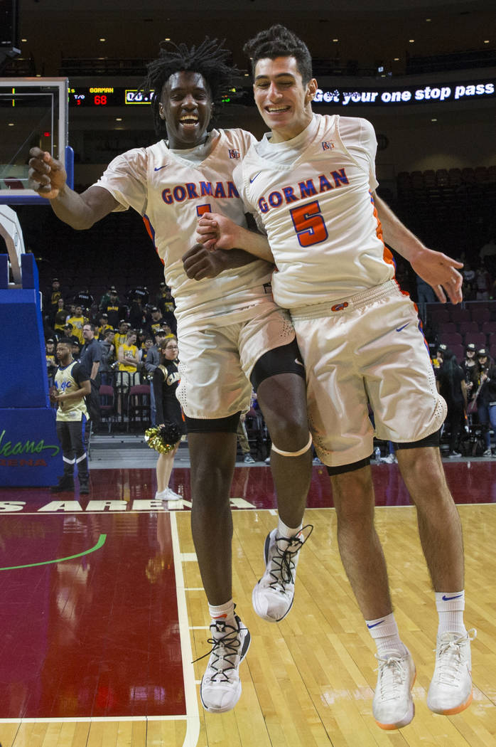 Bishop Gorman sophomore guard Will McClendon (1) and junior Mohammad Judeh Khalaf (5) celebrate after beating Clark 68-60 to win the Class 4A boys state championship on Friday, March 1, 2019, at O ...