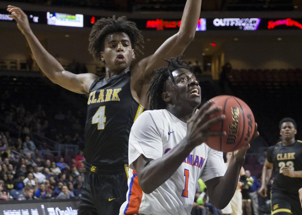 Bishop Gorman sophomore guard Will McClendon (1) drives past Clark senior guard Carlos Allen (4) in the fourth quarter of the Class 4A boys state championship game on Friday, March 1, 2019, at Orl ...