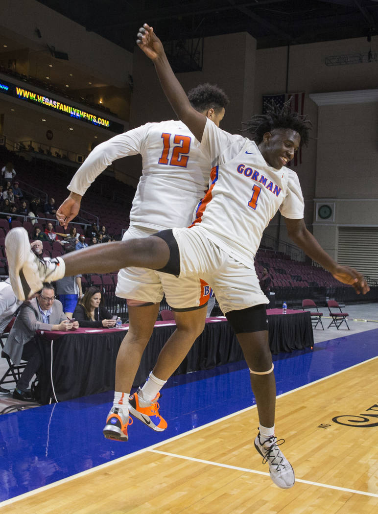 Bishop Gorman sophomore guard Will McClendon (1) and freshman forward Max Allen (12) celebrate after beating Clark 68-60 to win the Class 4A boys state championship on Friday, March 1, 2019, at O ...