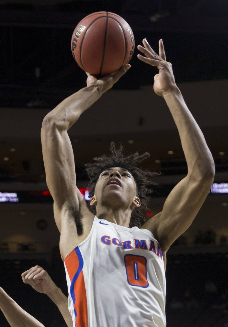 Bishop Gorman junior forward Isaiah Cottrell (0) converts a fast-break layup in the fourth quarter during the Gaels Class 4A boys state championship game with Clark on Friday, March 1, 2019, at Or ...