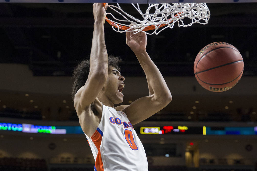 Bishop Gorman junior forward Isaiah Cottrell (0) converts a fast-break dunk in the fourth quarter during the Gaels Class 4A boys state championship game with Clark on Friday, March 1, 2019, at Orl ...