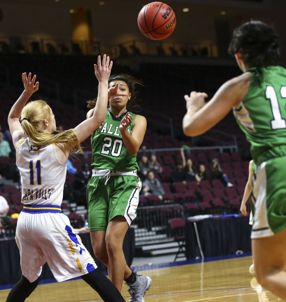 Churchill County's Leilani Otuafi (20) sends the ball past Moapa Valley's Kaitlyn Anderson (11) during the second half of the Class 3A girls basketball state championship game at the Orleans Arena ...