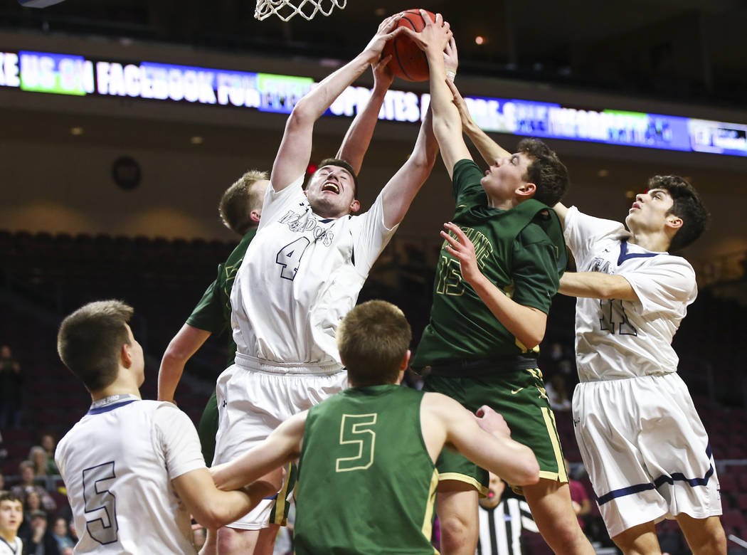 The Meadows forward Joe Epstein (4) reaches out for a rebound against Incline guard Brody Thralls (15) during the first half of the Class 2A boys basketball state championship game at the Orleans ...