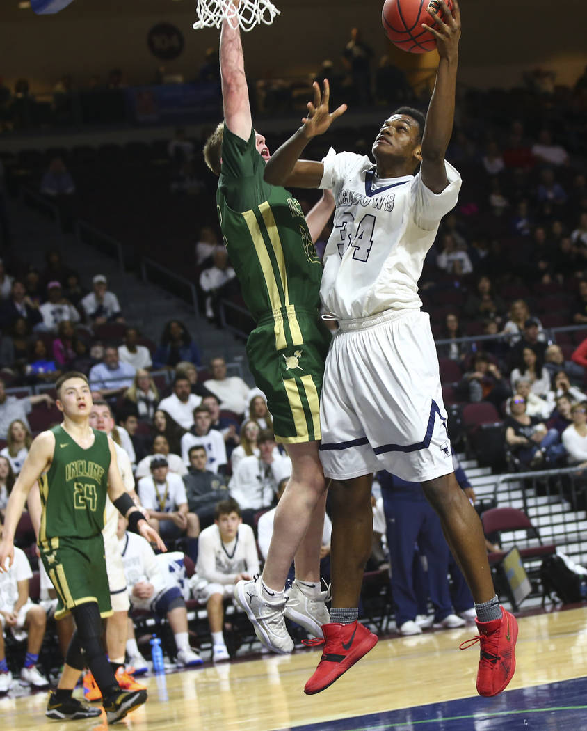 The Meadows' Obinna Ezeanolue (34) goes to the basket against Incline guard Liam Nolan-Bowers (22) during the second half of the Class 2A boys basketball state championship game at the Orleans Are ...