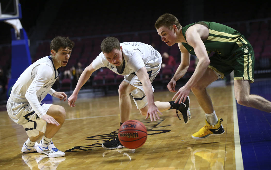 The Meadows' Noah Klein, left, and Allen Fridman, second from left, go after a loose ball against Incline's Ian Smith (5) during the second half of the Class 2A boys basketball state championship ...