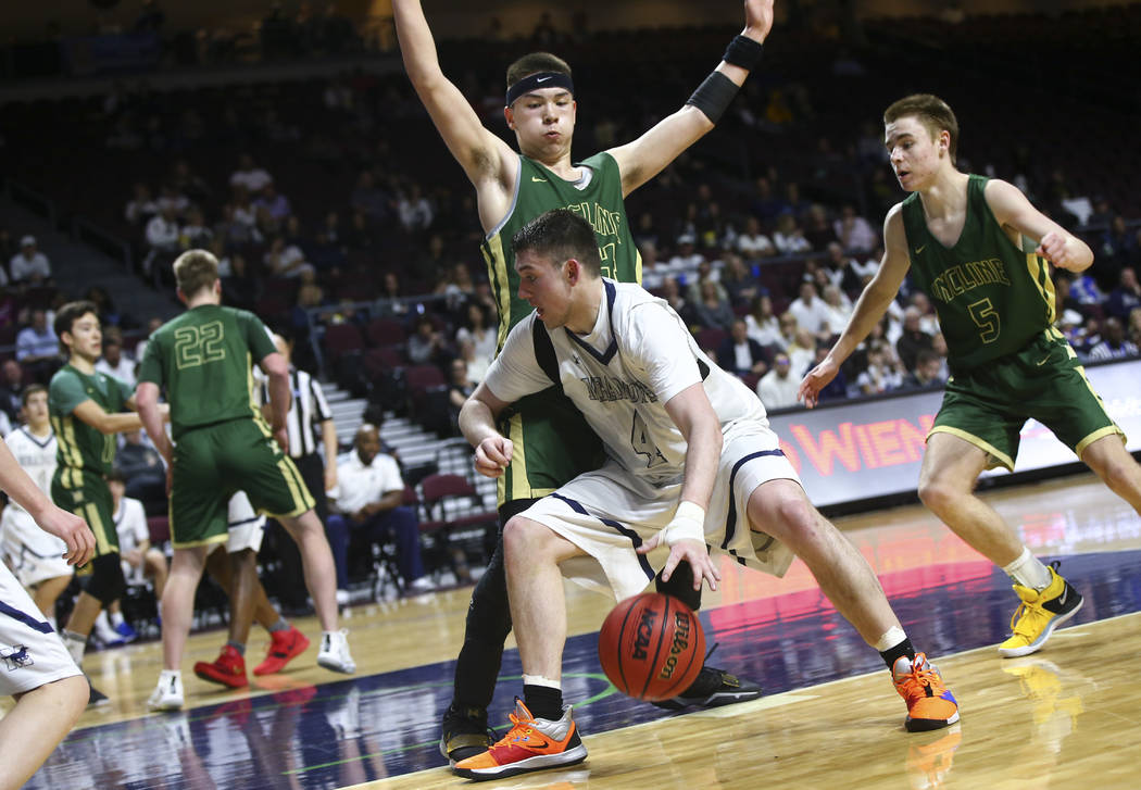 The Meadows forward Joe Epstein (4) moves the ball against Incline's TT Valosek during the second half of the Class 2A boys basketball state championship game at the Orleans Arena in Las Vegas on ...