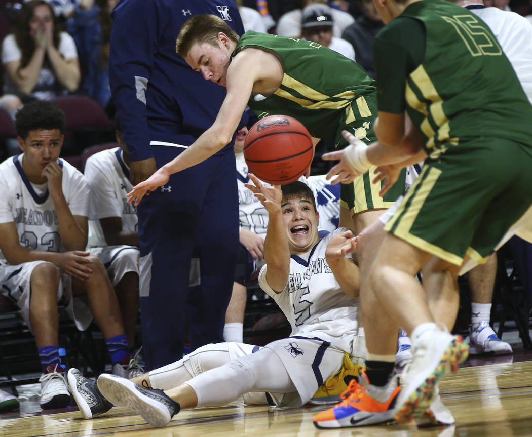 The Meadows guard Trey Covell (5) passes the ball under pressure from Incline during the second half of the Class 2A boys basketball state championship game at the Orleans Arena in Las Vegas on Sa ...