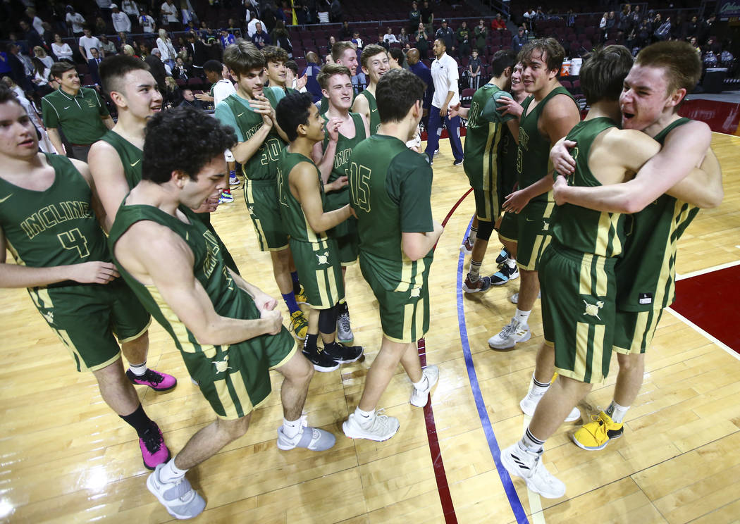 Incline players celebrate their win over The Meadows in the Class 2A boys basketball state championship game at the Orleans Arena in Las Vegas on Saturday, March 2, 2019. (Chase Stevens/Las Vegas ...