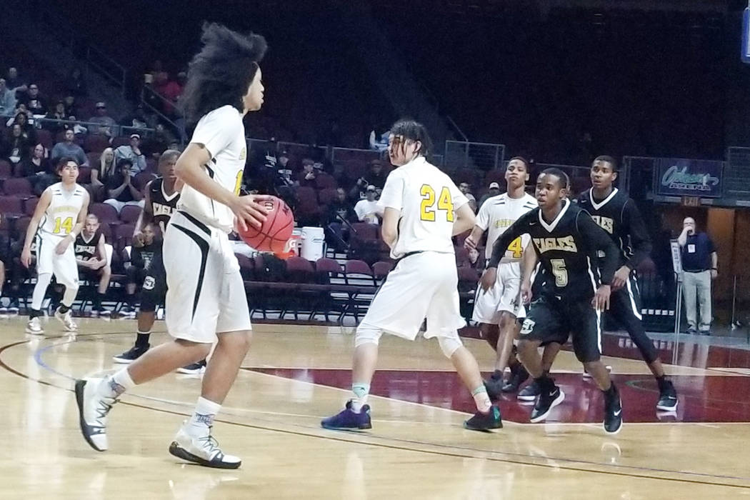 Mineal County's Robert McFalls looks to drive against Spring Mountain in the Class 1A boys state championship game at Orleans Arena on Saturday, March 2, 2019. Mineral County won 62-38. (Damon Sei ...
