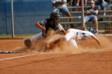 Shadow Ridge's catcher Caitlyn Covington (3) tags Centennial's Seanna Simpson (5) during the third inning of a softball game at Centennial High School in Las Vegas, Wednesday, April 25, 2018. Erik ...